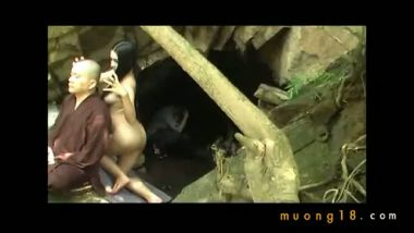 Buddhist monk doing tantric sex in outdoor cave