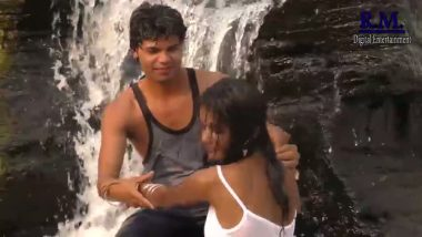 Outdoor romance under waterfall in bollywood
