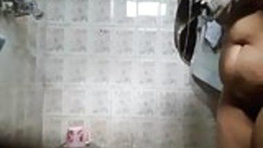 Sexy babe Rupali caught bathing