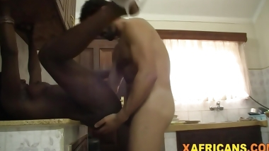 Busty African chick banged by white rod in kitchen