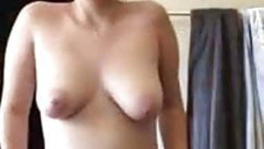 nerdy looking Indian babe recording