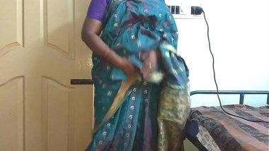 desi indian tamil telugu kannada malayalam hindi horny cheating wife vanitha wearing blue colour saree showing big boobs and shaved pussy press hard b