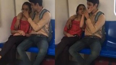 Lover Kissing In Metro train