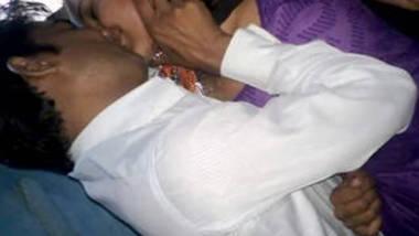 indian couple kissing purple salwar village