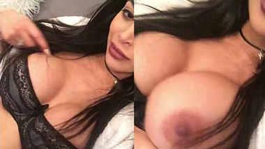 Sexy Brunette model xposing & licking her huge boobs