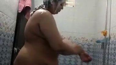 Fatty Desi woman's roomie sets hidden camera to film shower porn video