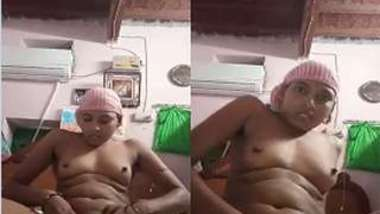 Naked Desi wears a pink towel on head and masturbates pussy