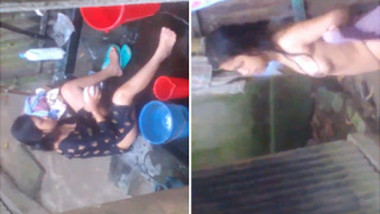 Naked Desi woman washes XXX assets outdoors not knowing about camera