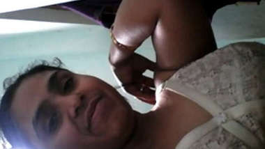 Desi female takes bra down showing off XXX boobs with dark sex nipples