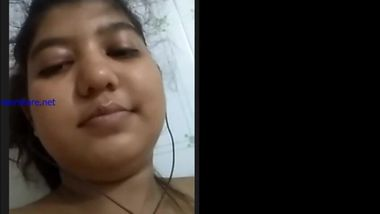 Cheeky Indian girl sticks her tongue out besides showing tits