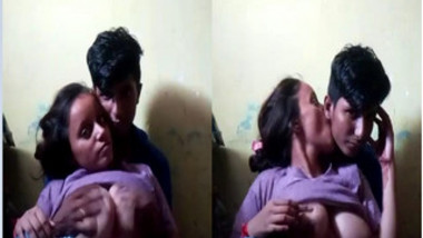 Voluptuous Desi female looks in sex camera while man touches her XXX jugs