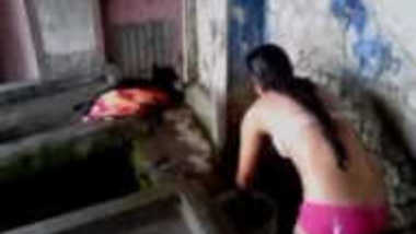 Woman washes her sex body wearing only XXX bra and panties on camera