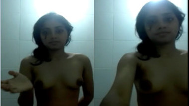 Naked Desi cutie films XXX video in which she touches her nipples
