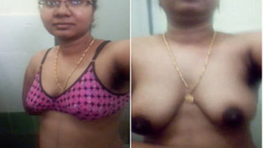 Attractive Indian woman with glasses shows XXX assets in bathroom