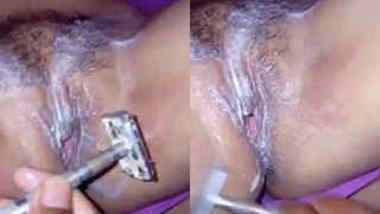 Careful Indian man shaves wife's XXX cave and fingers it before sex