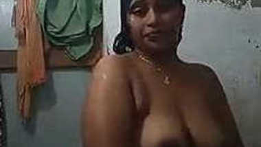 Female with Indian features soaps up her sex parts washing XXX body